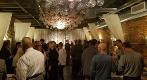 Members taste and mingle at the opening event for the Vinology wine club