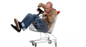 Elaborately dressed daredevils in decorated shopping carts