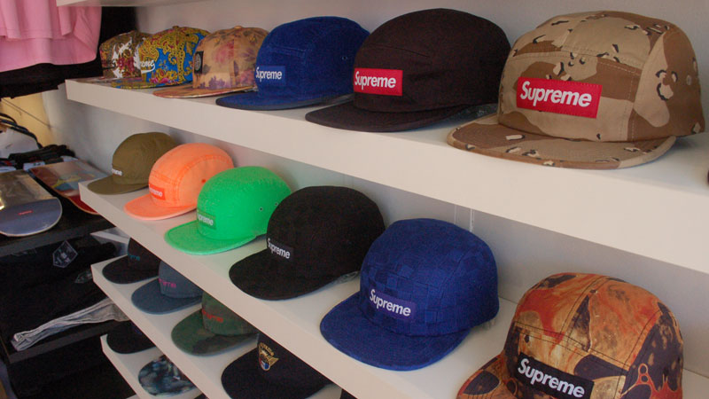 Supreme Five Panel Hats on display at the Motivation pop-up shop