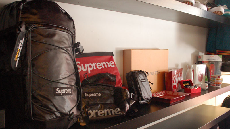 Supreme accessories behind the counter at the Motivation pop-up shop