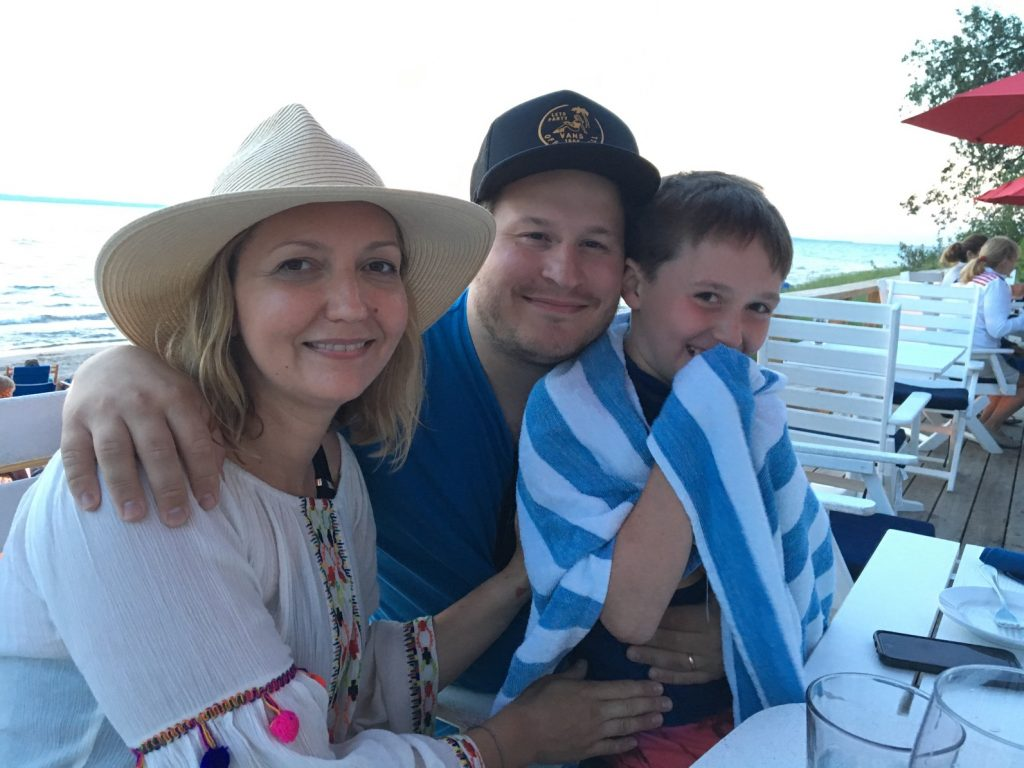 Scott Allen, center, with wife Heather, and stepson Sebastian