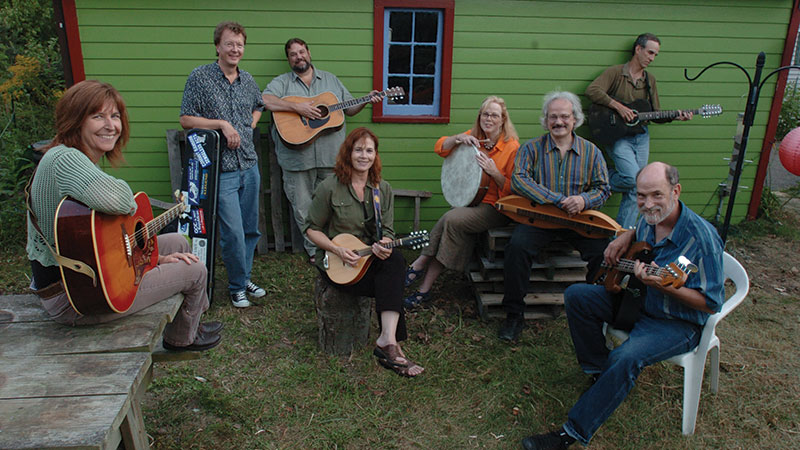 Left to right...Annie Capps, Jim Bizer, Matt Watroba, Kitty Donohoe (Center) Jan Krist (with Drum) David Tamulevich, David Barrett (against the garage) and Michael Hough (in white chair). Photo by Lon Horwedel