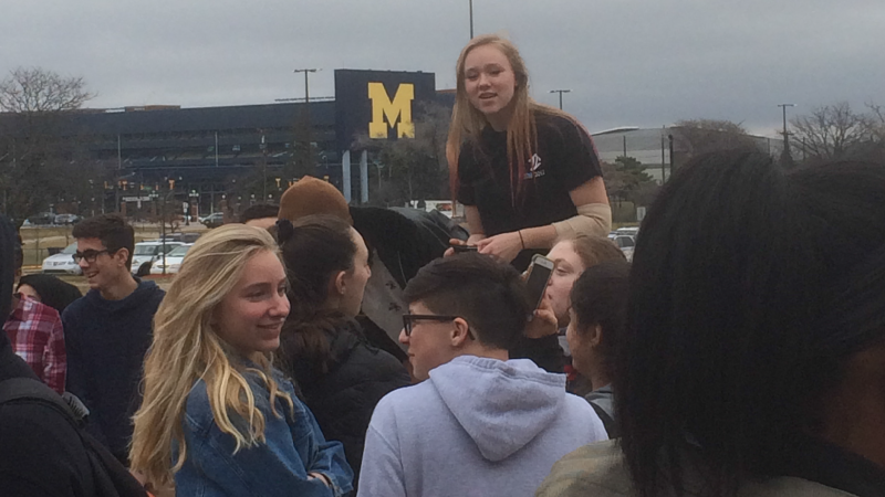 Senior Emma Roth above the crowd during the walk out