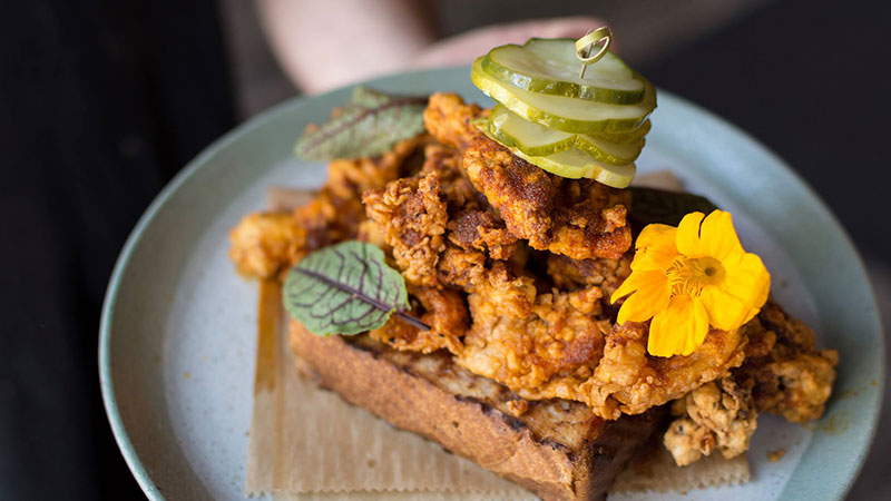 Nashville-style hot calamari served over brioche toast with local pickles