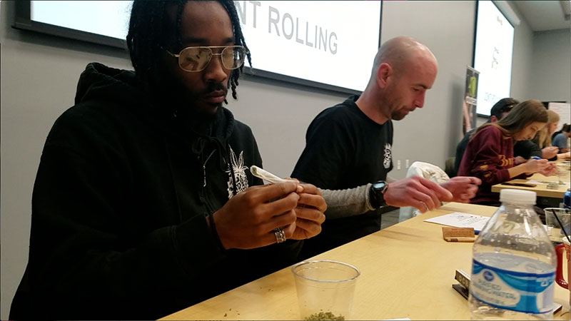 Patrick Shepard of Arbors Wellness works on his entry for the joint rolling competition.