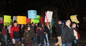 The crowd took to the streets with posters, banners, and drums.