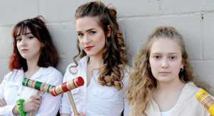 (L-R, Chloe Grisa, Samantha Torres, and Amy VanDyke star as Heather Duke, Heather Chandler, and Heather MacNamara.