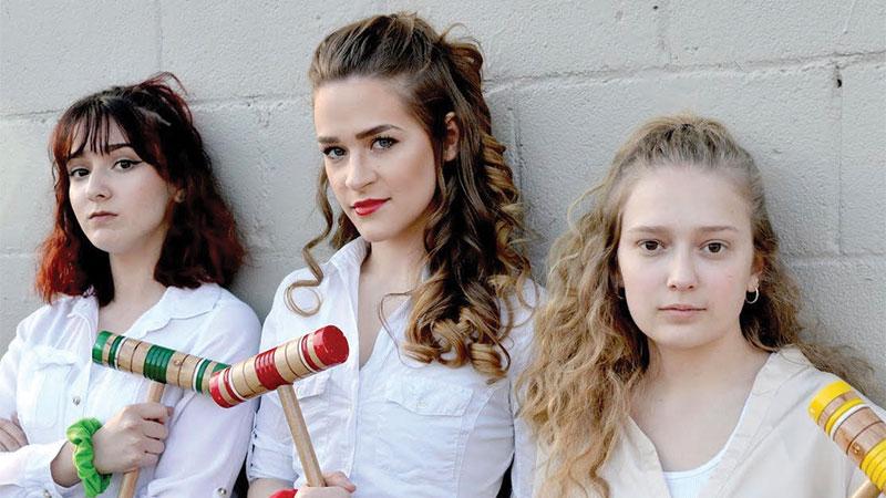 (L-R, Chloe Grisa, Samantha Torres, and Amy VanDyke star as Heather Duke, Heather Chandler, and Heather MacNamara.