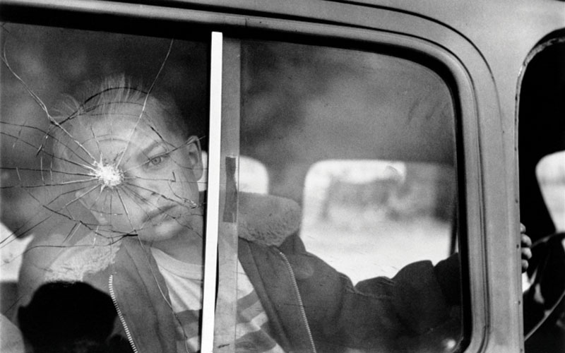 Elliott Erwitt, Cracked Glass with Boy—Colorado, 1955, gelatin silver print.