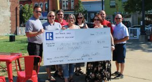 The Ann Arbor Board of Realtors gave $5,000 to lay the groundwork for a new park on Milan's Main Street.