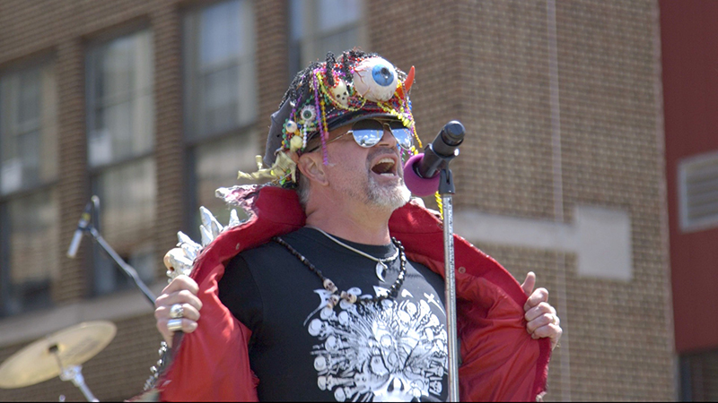 Sebastian Wreford, class of '83, dressed as Nitro von Borax at Community High School's 45th Commstock Reunion music festival. Wreford was a featured alum in the film and now works as the Manager of Food Donor Relations at Food Gatherers, coordinating Community's annual fundraiser that raised over $50,000 in 2017. Photo Credit: Donald Harrison