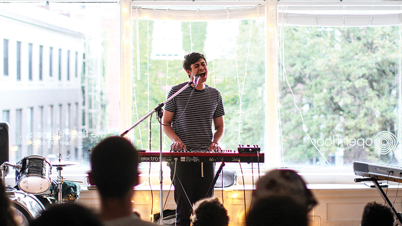 Detroit-based musician Jacob Sigman at The CoOp— an arts focused community center. Photo Credit: Erin Wakeland.