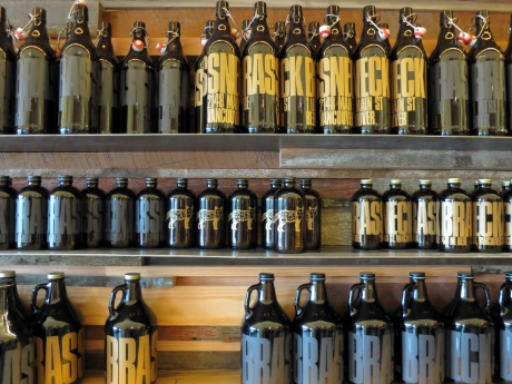 Beer bottles and beer growlers